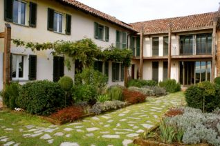 Exterior showing herb garden in courtyard